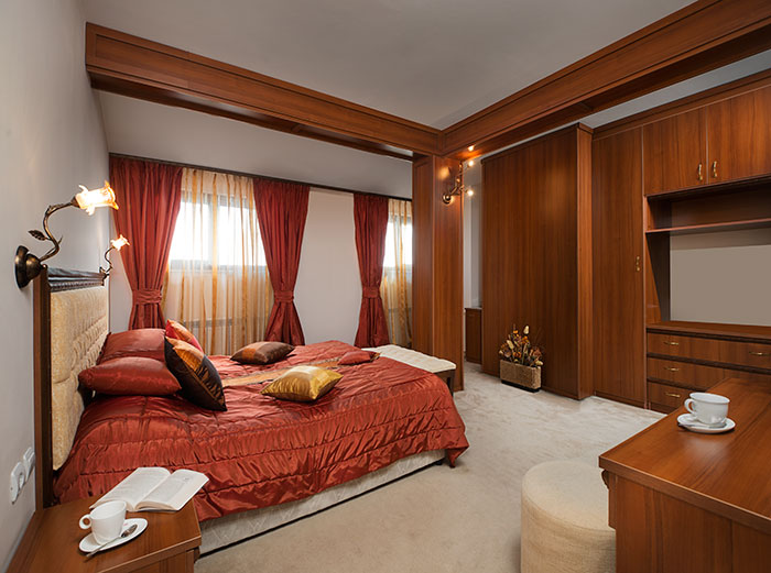 Bedroom in Deluxe Suite